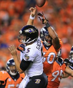 DENVER, CO - SEPTEMBER 5: Steve Vallos #60 of the Denver Broncos deflects a pass attempt from Joe Flacco #5 of the Baltimore Ravens in the third quarter during the game at Sports Authority Field at Mile High on September 5, 2013 in Denver Colorado. (Photo by Doug Pensinger/Getty Images)