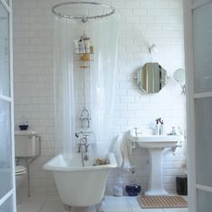 6-classic-style-bathrooms-Bath-Central - shower over roll top bath