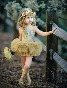 Our gorgeous GOLD Mistletoe Tutu is a new standard fit and design with a mistletoe applique braid on the front with layers of fully gathered skirt attached to a Girl Photography, Children Photography, Letter Photography, Birthday Photography, Photography Backdrops, Photography Ideas, Picture Outfits, Girl Outfits, Fashion Outfits