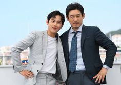 South Korean actor Yim Si-wan (L) and South Korean actor Sul Kyung-gu pose on May 25, 2017 during a photocall for the film 'Bulhandang' (The Merciless) at the 70th edition of the Cannes Film Festival in Cannes, southern France.  / AFP PHOTO / Anne-Christine POUJOULAT