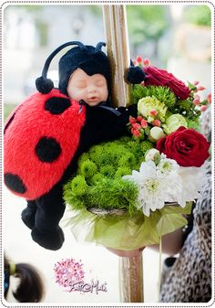 """Baby Lady Bug"" Anne Geddes toy christening candle www.facebook.com/faitamain www.simplyhappy.ro Christening Decorations, Baby Ladybug, Anne Geddes, Lady Bugs, Candels, Bee Theme, Kids Events, Flower Designs, Wedding Flowers"