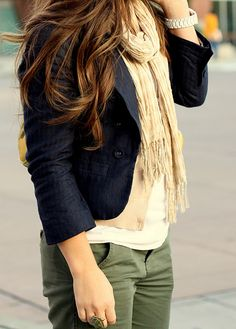 navy short jacket, cream scarf and green trousers