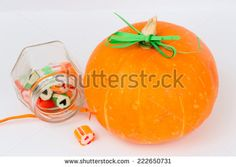 pumpkin candy jar love heart isolate white background - stock photo