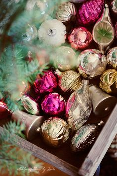 {wood box of mercury glass ornaments}