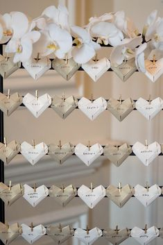 Love the idea of making name tags something that guests can take home... maybe some sort of origami...?!
