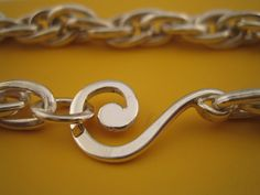 Sterling Silver Spiral chain link bracelet by OneHundredMonkeys
