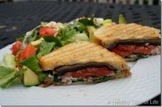 Grilled portobello mushroom sandwich with tomato, onion, spinach and  herbed goat cheese. Spinach and romaine salad on the side.
