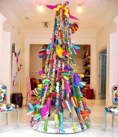 Christmas tree - artwork attached to strings/wire that are hung from the ceiling to the floor.