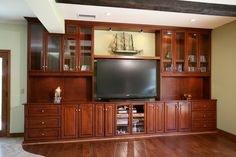 Entertainment center with glass doors a gorgeous built in entertainment center with glass door cabinetry black Custom Entertainment Center, Diy Entertainment Center, Home Theater Rooms, Home Improvement Projects, Home Living Room, My Dream Home, Woodworking Projects, Family Room, Entertaining