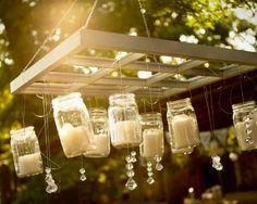 mason jar candle chandelier http://www.ilovefarmweddings.com/2014/04/21/brittany-jonathan-married-in-georgia/