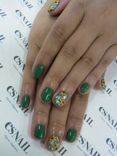 Green nails with feature. (Tiny flowers- so adorable)