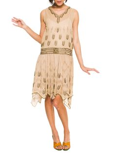 - Product Description - Measurements DETAILS Gold beads and crystals adorn this peach silk beauty from head to toe. The loose cut, the drop waist and the high-low hemline date this dress right at the