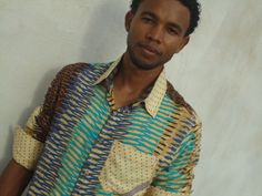 Intersting and very comfortable Men's Hawaiian Shirt made out of an african looking rayon fabric.  The colors range from blue, turquoise to beige and