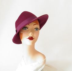 Vintage woman's fedora hat plum with feather by TheVintageHatShop