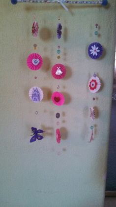 Rosette mobile easy and inexpensive to make. Beads butterflies colored caedstock. Fishing wire dowel done