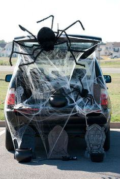 Spider Web Trunk or Treat Theme  Put a dollar black table cloth lining truck or diving front n back use the spider web to covet Maybe use toilet paper roll glue n the dark eyes to put thru out...