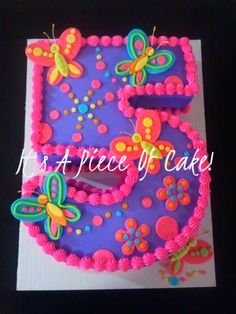Double layer cut from a half sheet cake, buttercream icing, fondant butterflies
