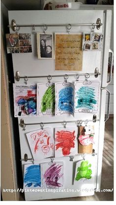 Add some shower curtain rings and rods to the side of your fridge for an easy-to-customize kids art gallery.