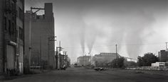 On a damp morning smoke and steam rise from the Edgar Thompson Works in this…