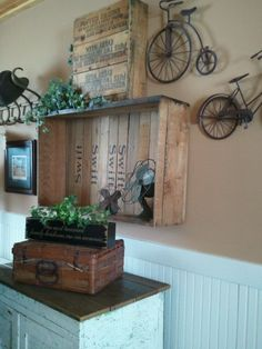 Old advertising crates, vintage suitcase, bicycle art, vintage fans - Very nice!