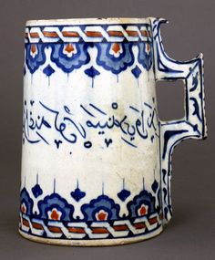 Object type      vessel     tankard  Museum number  G.130 Description  Vessel (humpen-shaped), tankard. Handle decoratively stitched,cable and lappet bands and Ottoman inscription round body. Made of cobalt, red (bole) painted and glazed ceramic, pottery. School/style      Iznik  Culture/period      Ottoman dynasty term details  Date      16thC
