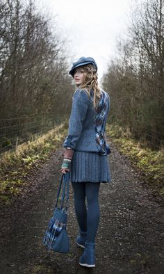The girls on Arran still dress very Scottish.  Moira has on a Tartan Spirit Harris Tweed Suit in 'Airforce' full length detail..............