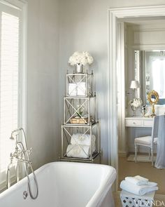 This bathroom's smaller scale and soft colors make it an intimate retreat. Étagère, Mitchell Gold + Bob Williams. Tub, Waterworks. Fittings, Lefroy Brooks. Image originally appeared in the April 2011 issue of Veranda. INTERIOR DESIGN BY JAMES MICHAEL HOWARD   - Veranda.com