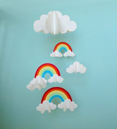 Rainbows and Clouds 3D Hanging Baby Mobile/3D Paper Mobile/Nursery Mobile. $55.00, via Etsy. OR try it myself & see what I can get?