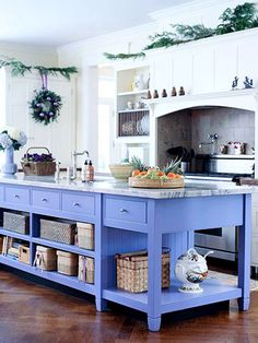 like the way they brought in color to a boring kitchen with this great painted, marble top island!