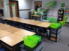 Another idea for keeping materials near the desks but not in them.  Another picture showed library books in the green bin. This would reduce the traffic in the library. Change them out each week.