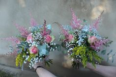 Bridesmaids bouquets in pastels with solidago, belle rose, astilbe, gypsophila and senecio