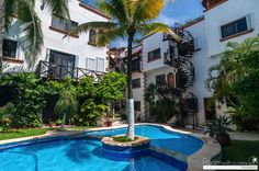 If you are looking at real estate in Playa Del Carmen, you could be wondering whether it is possible to really own a real estate in Mexico. Playa del Carmen is often a beautiful place that lots of foreigners yearn to have home. Santorini, Villas, Ideal Home, Condo, Beautiful Places, Real Estate, Vacation, Mansions, House Styles