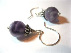 Gorgeous faceted Amethyst rounds are capped with detailed Bali sterling silver beads. Very dainty!Suspended on hand-formed sterling ear wires. Measures approximately 1 1/4inches in length from top of ear wire to bottom of bead. These are promptly made to order and quickly shipped.