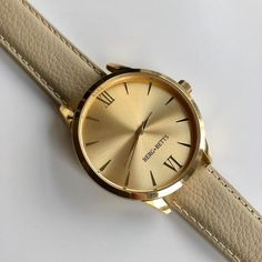 Sustainable and ethically made round watch features a mirrored gold stainless steel case, gold markers and a sustainable ivory leather band meticulously crafted from surplus leather that would have otherwise gone to waste. Leather Scraps, Gold Face, Watch Faces, Timeless Classic, Stainless Steel Case, Quartz, Ivory, Mindfulness, Watches