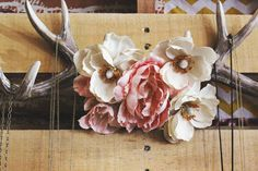 Today we whipped up a cute and super easy project for Emma's bohemian styled bedroom. This project only takes about 30 minutes and it's so fresh and pretty... perfect for spring. Enjoy! 1. Supplies: Antlers (ours are faux from Hobby Lobby), silk floral stems, green felt, hot glue gun, scissors. 2. Begin by taking the flowers off the stem and applying a thin layer of glue between the petals and...
