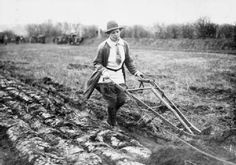 Land Army women operates a single-furrow plough on a British farm during the First World War