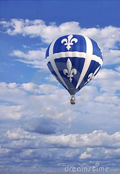 Photo about Quebec flag designed hot air balloon floating high in a blue cloudscape sky in celebration of Saint-Jean-Bapiste day. Image of baloon, june, cloudscape - 18039452 Quebec Montreal, Old Quebec, Montreal Ville, Quebec City, Province Du Canada, The Province, Fete St Jean Baptiste, O Canada, Canada Travel