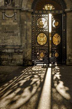 Sun shining through beautiful ironwork doors!