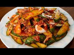 """[Fri May 8, 2015 PM]Spicy cucumber side dish (Oi-muchim) ts a spicy Korean cucumber side dish called oi-muchim. If you have a nice seedless English cucumber, you can make this delicious banchan in just a few minutes. During my round the world Gapshida trip to meet my readers in 2011, I made this dish almost everywhere I went. Everybody loved it. Who wouldnt like cold, fresh, crispy, seasoned cucumber? Each bite is succulent and wonderful!  Oi means """"cu"""