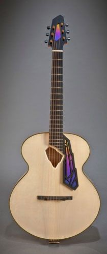 """Decodence model. 16"""" non-cutaway archtop guitar with chamfered, angular soundhole. Hand carved European spruce top with X or fan bracing. Hand carved curly European maple back and sides. Hand made by luthier Erich Solomon. 22 Old Stagecoach Road. Epping, New HAmpshire 03042. USA.. www.solomonguitar...."""