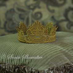 Embroidered freestanding lace crown.