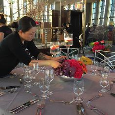 Keiko one of our Head Designers finesses an arrangement for a wedding rehearsal dinner at the @rainbowroomnyc  #ovandony #ovandodesign #eventproduction #eventdecor #nyevents #weddingproduction #rainbowroomnyc #floral #luxury #design by ovandony