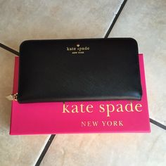 Kate Spade wallet ♠️ NO TRADES OR PAYPAL PLEASE Authentic Kate Spade wallet in black. I think it was part of last years spring collection. It has never been used, comes with the box. What you get is basically how I purchased it. This is the first time I've taken it out since buying. I found a slight flaw on the back shown in last pic. Must of came that way since I've never used it. kate spade Bags Wallets