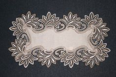 Decorative Place Mats,Tray Mats, Doilies in Ivory Edged in Embroidered Lace        Item Description       These lace place mats have a heavy lace trim around the edges and are available in Ivory. They are made from polyester making them durable and machine washable.  Small square measures approximately 30cm/12'' (Length) x 30cm/12'' (Width), medium square 40cm/16'' (Length) x 40cm/16'' (Width) and oblong measures 50cm/20'' (Length) x 35cm/14'' (Width) including the trim.  These place mats…