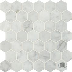 This versatile, classic marble will complete your traditional or contemporary (or even modern!) kitchen design. Our Carrara White collection includes various patterns and sizes including the very popular hexagon, basketweave, trapezoid, and the more customary 2x4 and 3x6. #walltilewednesday #tile #backsplash