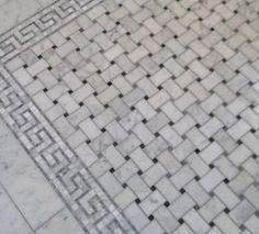 Basketweave marble bath floor tiles with greek key border. by sherrie