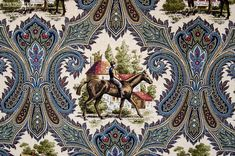 A horse jockey toile fabric. A horse riding toile paisley fabric. An elaborate paisley pattern, predominately done in deep blue, lighter dusty blue, gold, browns ,and grey, with touches of red and beige, forms a border around two scenes that alternate on the fabric.  #fabric #horse #jockey #sewing #homedec #homedecor #homedecorating #home_decorating #interior #design #interiordesign #ideas #inspiration #country #interior_design #houzz #home_decor #home_dec