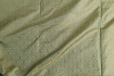 This Benares silk is in grass green with geometrical pattern thread work in gold zari. This is a lovely fabric for both male and female and perfect to be adorned at any age. ¾