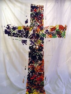 Cross made from handprints