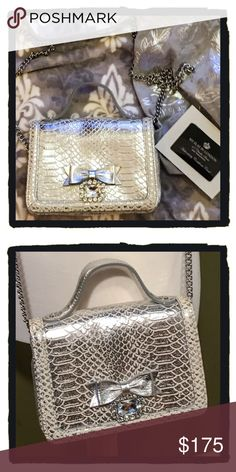 NWT My Flat in London Evening Bag Perfect for the holiday season!!  My Flat in London evening bag.  Removable shoulder strap. Comes with dust cover. NWT!!  Beautiful bag!! Brighton Bags